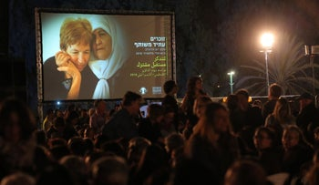Participants gather for an alternative Israeli-Palestinian joint memorial ceremony in Yarkon Park, Tel Aviv on Tuesday April 17, 2018.
