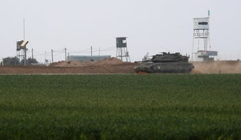 An Israeli tank manoeuvres along the border fence with the southern Gaza Strip, Israel, February 17, 2018