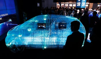 A model of a car displays sensor technology made by Israel's Intel Mobileye: At the Intel booth during CES International, Tuesday, Jan. 9, 2018, in Las Vegas.