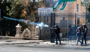 File photo: Israeli Border Police officers shoot tear gas toward Palestinian protesters in Bethlehem, March 2018.