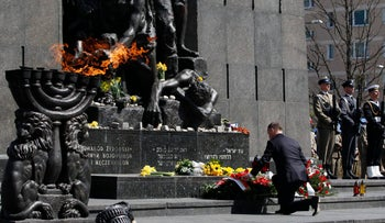 Polish President Andrzej Duda lays a wreath during state ceremonies in homage to the victims and fighters of the 1943 Warsaw Ghetto Uprising, on the 75th anniversary of the start of the revolt, in front of the Monument to the Warsaw Ghetto Heroes, in Warsaw, Poland, Thursday, April 19, 2018.