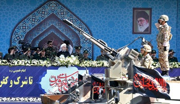 Iran's President Hassan Rohani reviews a military parade during the 37th anniversary of Iraq's 1980 invasion of Iran, September 22, 2017.