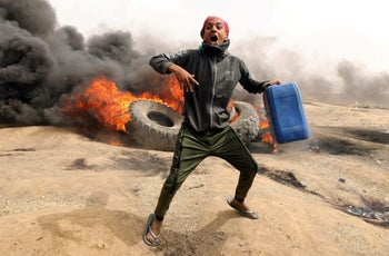 A demonstrator shouts during clashes with Israeli troops at a protest at the Israel-Gaza border where Palestinians demand the right to return to their homeland, east of Gaza City April 20, 2018.