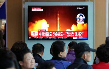 People watch a TV showing a file footage of North Korea's missile launch during a news program at the Seoul Railway Station in Seoul, South Korea, Saturday, April 21, 2018.