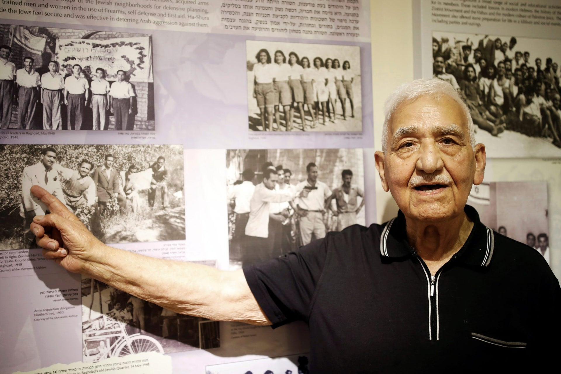 Zevulun Hareli, 90, who immigrated from Iraq to Israel in 1949, points at photos on display at the Babylonian Jewry Heritage Center in Or Yehuda, Israel, April 16, 2018.