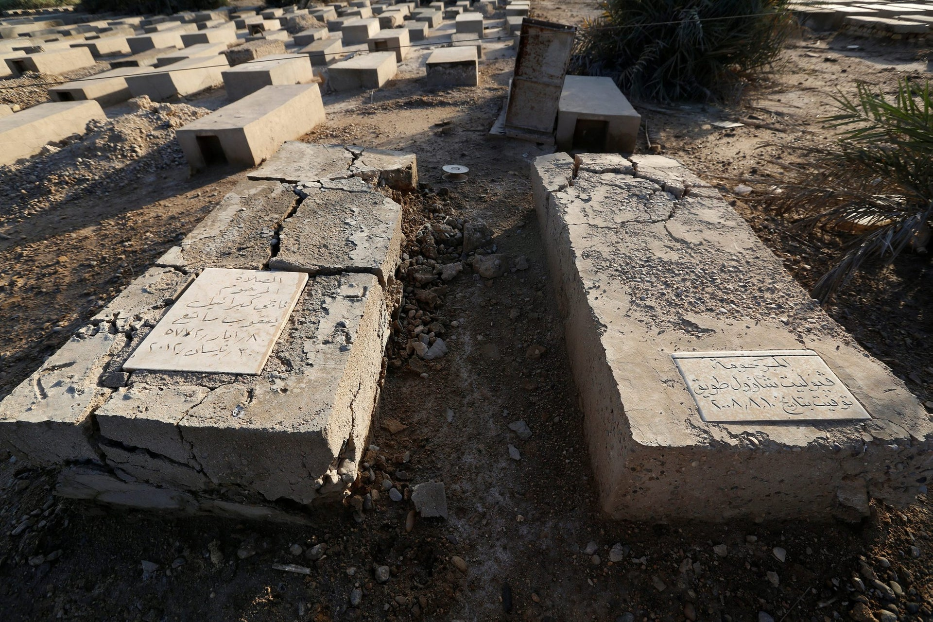 A tomb of a nurse Violet Saul (R), who was buried in 2008, is seen at a Jewish cemetery in the Sadr City district of Baghdad, Iraq April 1, 2018.