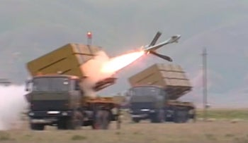A still from the video shows a launch of the IAI Harop loitering munition system, an anti-radiation drone that is fired from a 12-missile launcher, usually carried on a truck.