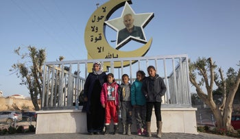 The family of Yakub Abu al-Kiyan, who was shot and killed by police after his vehicle hit and killed officer Erez Levi last year, stand in front of his memorial in Hura, April 9, 2018.