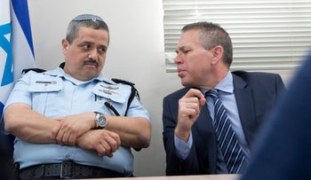 Israel's Public Security Minister Gilad Erdan (right) and Police Commissioner Roni Alsheich.