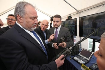 Defense Minister Avigdor Lieberman visiting a factory of Elbit, the defense electronics company.