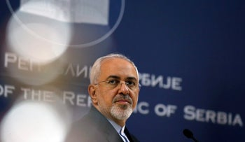 Iranian Foreign Minister Mohammad Javad Zarif listens to a question during a press conference after talks with his Serbian counterpart Ivica Dacic, in Belgrade, Serbia, Monday, Feb. 26, 2018. Zarif arrived on a two-day visit to Belgrade. (AP Photo/Darko Vojinovic)