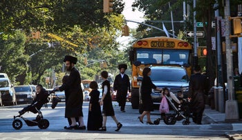 Residents of the Orthodox Jewish community in the Borough Park section of New York's Brooklyn borough, September 2013
