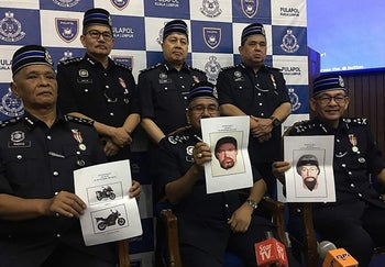Malaysia Chief Police Mohamad Fuzi Harun (C) with other police officials holding computer-generated images of suspects involved in assassinated a Palestinian scientist in a drive-by shooting in Kuala Lumpur.