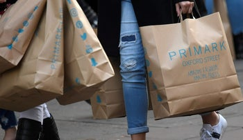 Shoppers carry Primark bags.
