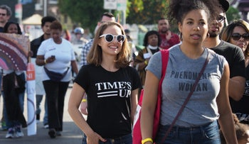 """Natalie Portman, wearing a """"Time's Up"""" T-shirt, marching in a parade honoring Dr. Martin Luther King Jr., January 15, 2018, Los Angeles."""