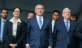 FILE PHOTO: Israeli chief justice Esther Hayut, Prime Minister Benjamin Netanyahu and President Reuven Rivlin attend a ceremony in Jerusalem, November 1, 2017.