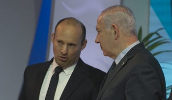 Party chairman of Habayit Hayehudi Naftali Bennett and Prime Minister Benjamin Netanyahu at the Israel Prize ceremony, April 2018.