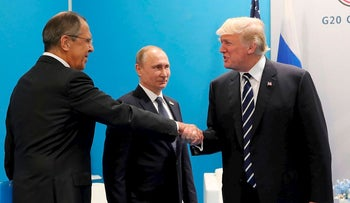 In this July 7, 2017, file photo, President Donald Trump, right, greets Russian Foreign Minister Sergey Lavrov, left, prior his talks with Russian President Vladimir Putin, center, during the G20 summit in Hamburg Germany