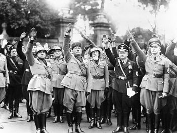 Benito Mussolini, second left, celebrating the 14th anniversary of Italian fascism in 1936. Liberation Day marks the end of Nazi occupation and fall of Mussolini's party in 1945.