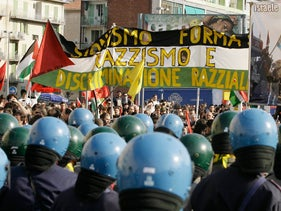 Italian police officers, with blue helmets, look on during a demonstration described by organizers as pro-Palestinian, in Turin, Italy, 2008