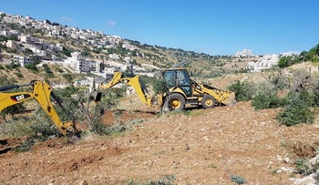 Uprooting of olive trees to clear room for construction, April 23, 2018