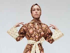 A model wearing a Batsheva dress that brings to mind Amish clothing.