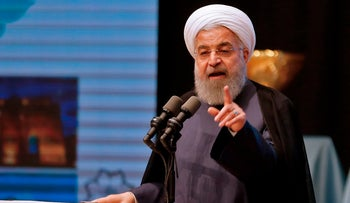Iran's President Hassan Rouhani gives a speech in the city of Tabriz in the northwestern East-Azerbaijan province on April 25, 2018