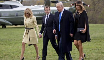 U.S. First Lady Melania Trump, President Donald Trump, Emmanuel Macron, and Brigitte Macron arrive from Marine One at the Mount Vernon estate of first U.S. President George Washington in Virginia, on April 23, 2018.