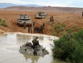 An Israeli tank submerged in water in the south.