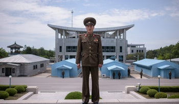 In a photo taken on June 2, 2017 Korean People's Army (KPA) soldier Lieutenant Kim poses for a portrait before the military demarcation line at the truce village of Panmunjom within the Demilitarized Zone (DMZ) separating North and South Korea.  North Korean leader Kim Jong Un on April 27 will have a historic summit with the South's president Moon Jae-in -- a major setpiece of the diplomatic whirlwind over the flashpoint peninsula as the young leader prepares for a highly-anticipated meeting with Donald Trump.   / AFP PHOTO / Ed JONES / To go with SKorea-NKorea-politics-diplomacy, ADVANCER by Jung Hawon