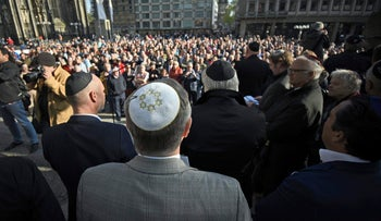 Men wear kippah as they attend a demonstration against anti-Semitism in Cologne, April 25, 2018.