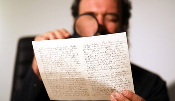 Meron Eren of Kedem Auction House holds a letter handwritten by composer Richard Wagner in 1869, before it is sold at an auction in Jerusalem, April 24, 2018.
