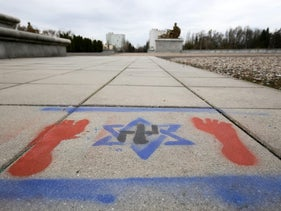A sign featuring a swastika and Star of David, graffitied at the Soviet Military Cemetery Mausoleum in Warsaw, Poland, March 2017.