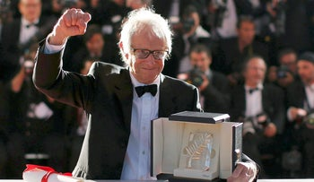 """Director Ken Loach, Palme d'Or award winner for his film """"I, Daniel Blake"""", poses during a photocall after the closing ceremony of the 69th Cannes Film Festival in Cannes, France, May 22, 2016."""
