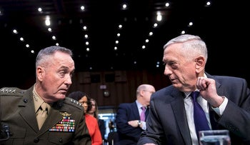 Chairman  of the Joint Chiefs of Staff Joseph F. Dunford Jr. (L) and US Secretary of Defense James Mattis talk before a hearing of the Senate Armed Services Committee on Capitol Hill April 26, 2018 in Washington, DC
