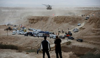 Israeli rescue services personnel operate near the site where a group of Israeli youths was swept away by a flash flood, Israel, April 26, 2018.