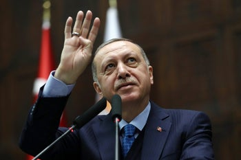 Recep Tayyip Erdogan greets the audience as he delivers a speech in Ankara, April 24, 2018.