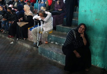 People wait to travel into Egypt from Gaza after the Rafah border crossing was opened for three days for humanitarian cases on April 28, 2018.