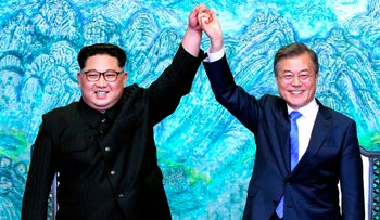 In this Friday, April 27, 2018, file photo, North Korean leader Kim Jong Un, left, and South Korean President Moon Jae-in raise their hands after signing a joint statement at the border village of Panmunjom in the Demilitarized Zone.