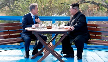 North Korean leader Kim Jong Un nd South Korean President Moon Jae-in talk at the border village of Panmunjom in the Demilitarized Zone, South Korea, April 27, 2018.