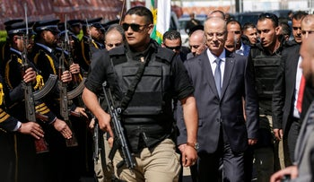 Palestinian Prime Minister Rami Hamdallah, right, after the explosion during his visit to the Gaza Strip in March 2018.
