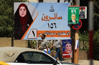 An campaign poster in Baghdad shows the candidate Magda Al-Tamimi ahead of the May 12 parliamentary elections.