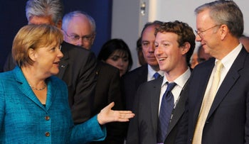 German Chancellor Angela Merkel meets with Facebook's Mark Zuckerberg and Google's Eric Schmidt at the G8 summit in Deauville, France, May 26, 2011.