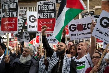 An 'ideological convergence': Protesters chant during a pro-Gaza demonstration outside the Israeli embassy in London. August 1, 2014