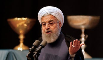 Iran's president Hassan Rohani gives a speech in the city of Tabriz in the northwestern East-Azerbaijan province on April 25, 2018