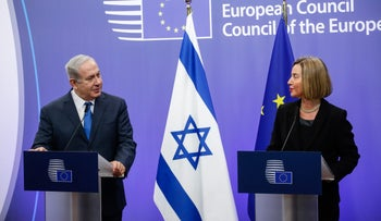 Benjamin Netanyahu and Federica Mogherini speak during a news conference at the European Council in Brussels, December 11, 2017