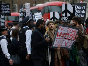 Protesters block traffic outside Downing Street during a demonstration organised by the Stop the War Coalition against military intervention by western allies in Syria. London April 13, 2018.