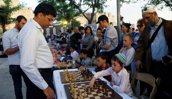 Former Indian chess world champion Viswanathan Anand plays simultaneous matches during an event marking Israel's 70th anniversary at Jerusalem's Old City's Jaffa Gate, April 30, 2018.
