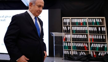 Prime Minister Benjamin Netanyahu presents material on Iranian nuclear weapons development during a press conference in Tel Aviv, Monday, April 30 2018.