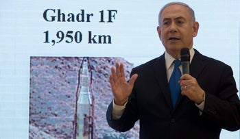 Israeli Prime Minister Benjamin Netanyahu presents material on Iranian nuclear weapons development during a press conference in Tel Aviv, Monday, April 30 2018